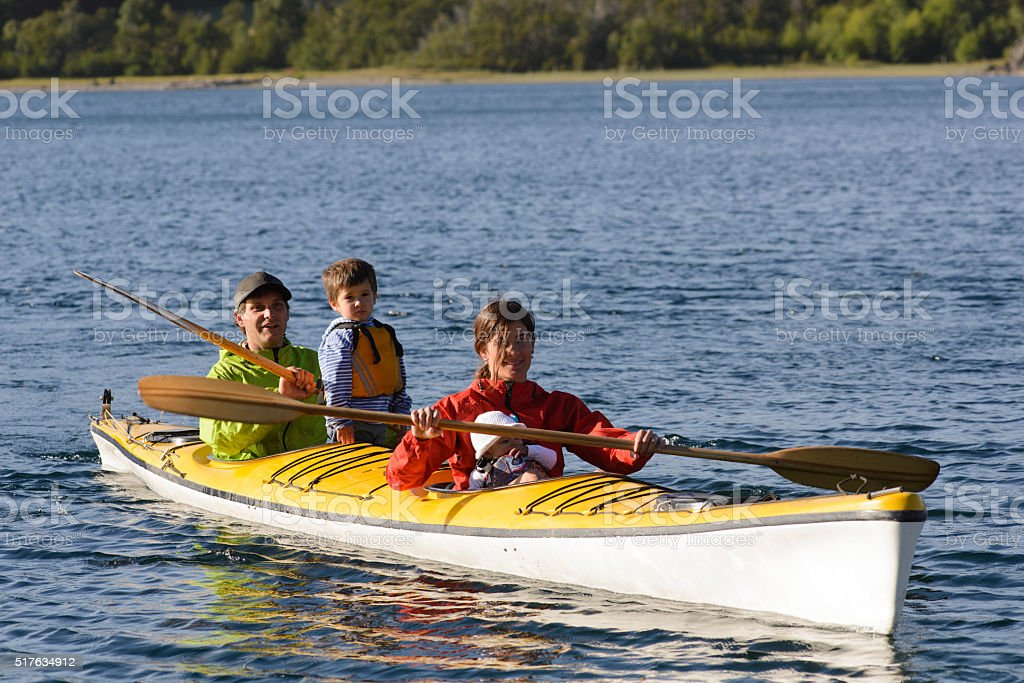 Famili Paddling in Patagonia stock photo
