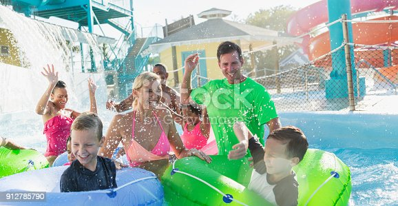 1091098220 istock photo Families and friends at water park on lazy river 912785790
