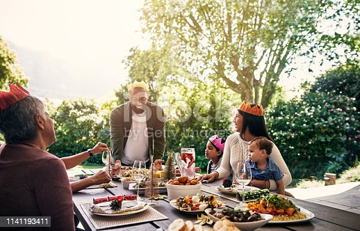 Shot of a happy family having Christmas lunch together at home
