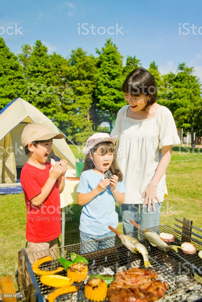 Families enjoy the BBQ royalty-free stock photo