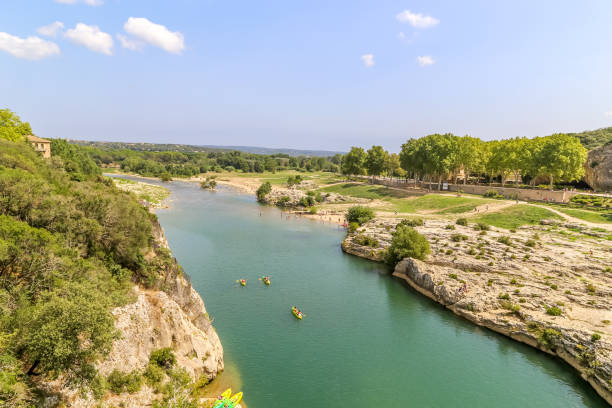 Families enjoy water sports and hikes in the Pont Gard area. stock photo