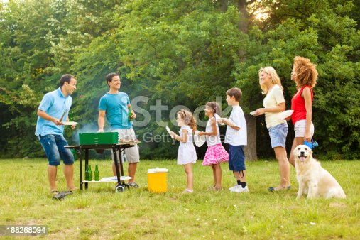 istock Families enjoying a barbecue. 168268094