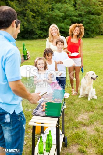 istock Families enjoying a barbecue. 168466734