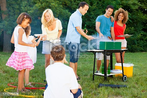 istock Families enjoying a barbecue. 171275278