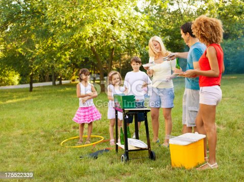 istock Families enjoying a barbecue. 175522339