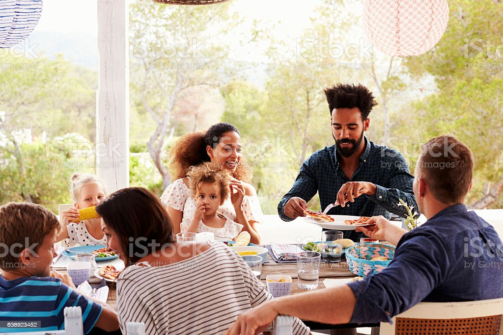 Families Enjoying Outdoor Meal On Terrace Together - foto de stock