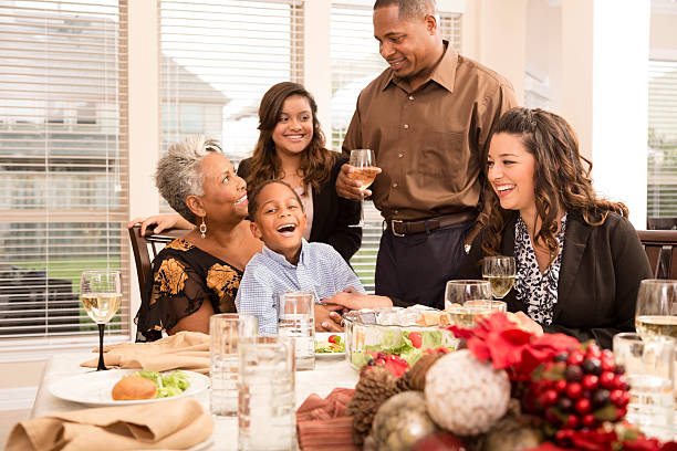 Families Family Gathers For Christmas Dinner Or Holiday Party Stock Photo