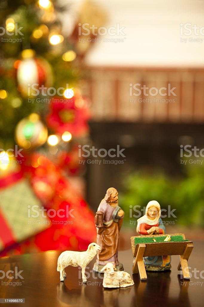 Families Mary, Joseph and Baby on table by Christmas tree royalty-free stock photo