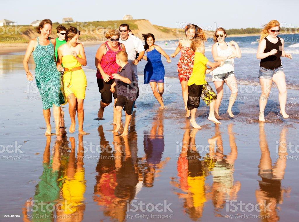 Families Running on the Beach stock photo