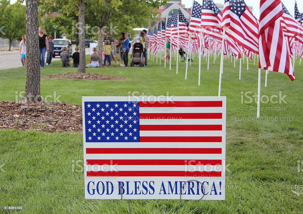 Families walk behind God Bless America sign Utah's Healing Field® stock photo