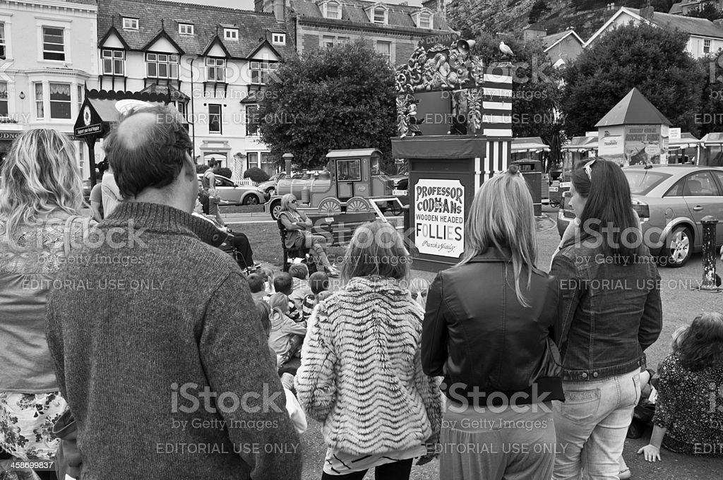 Families watching seaside punch and judy puppet show royalty-free stock photo