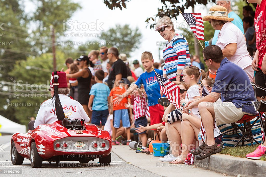 Families Wave American Flags At Old Soldiers Day Parade stock photo