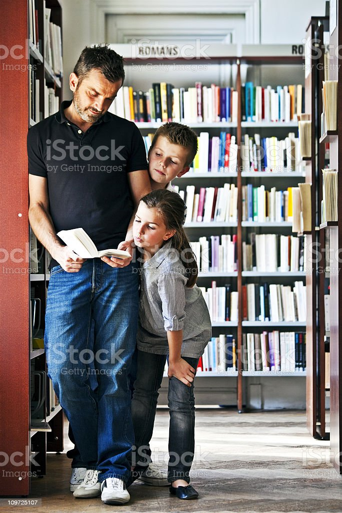 familiy in library royalty-free stock photo