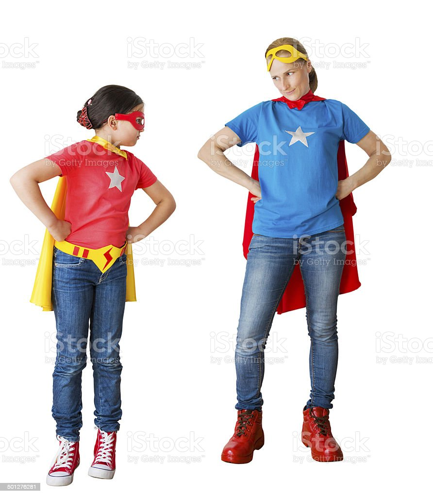 family acting as super hero stock photo