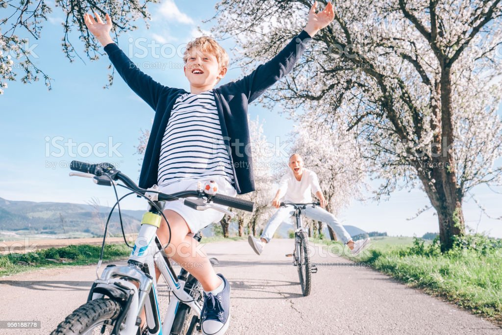 Family active leisure - father and son have a fun when they ride a bicycles stock photo