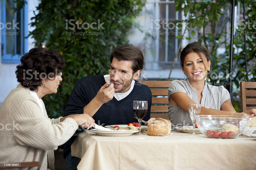Family affairs - young couple and mother stock photo