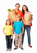 Full length portrait of happy family standing with paper bags after shopping. Vertical Shot. Isolated on white.