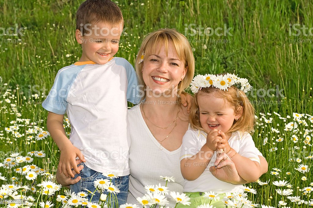 Family among flowers royalty-free stock photo