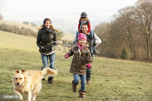 istock Family and dog on country walk in winter 155360161