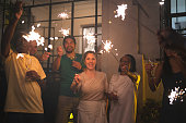 istock Family and Friends Celebrating New Year Party with Sparkler at Home 1072689248
