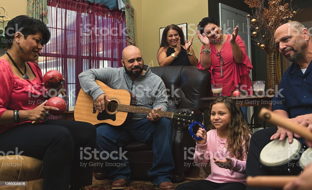 Family and friends celebrating with music stock photo