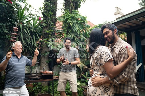 istock Family and Friends Enjoying a Barbecue Party at Home 1080426752