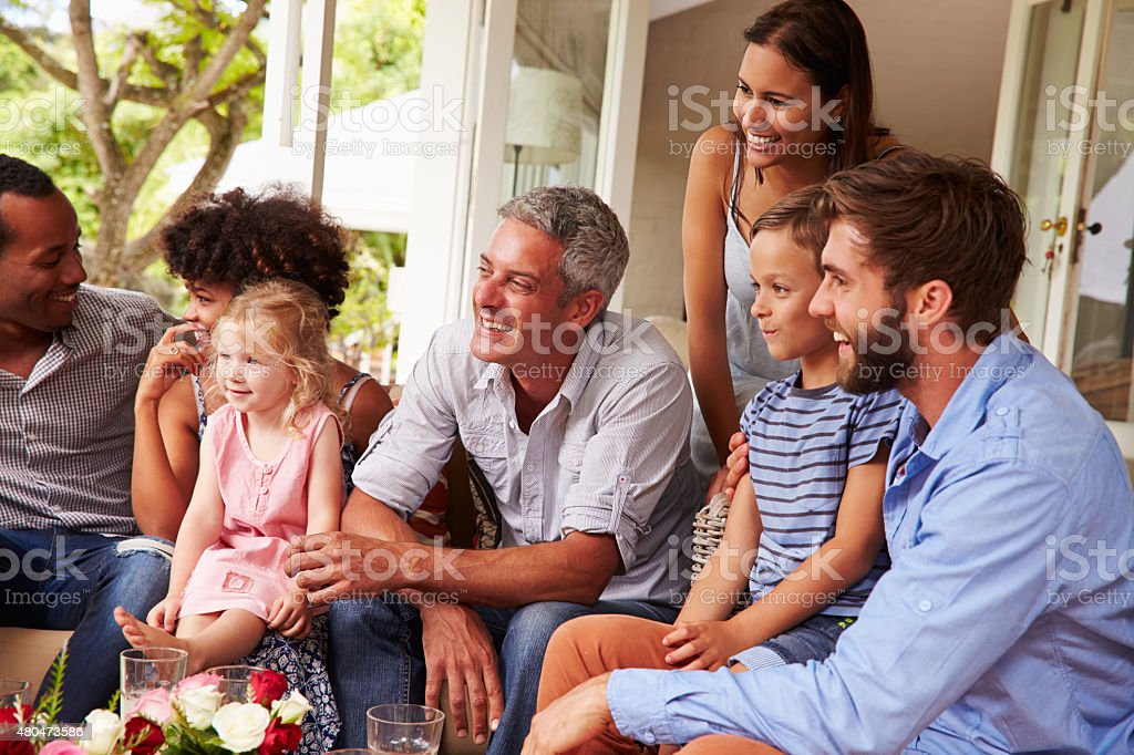 Family and friends gathered in a conservatory stock photo