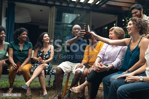 istock Family and Friends on Celebratory Toast at Birthday Barbecue Party at Home 1080426610