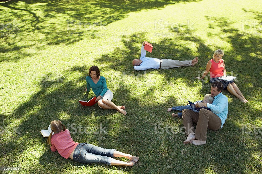 Family and friends reading together stock photo