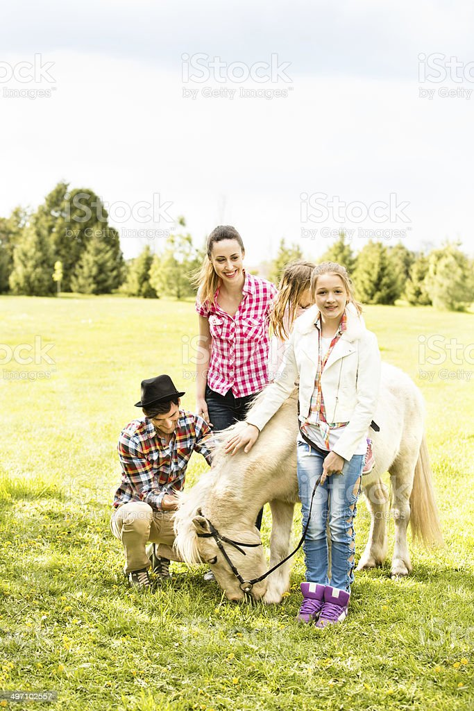 Family and horse royalty-free stock photo