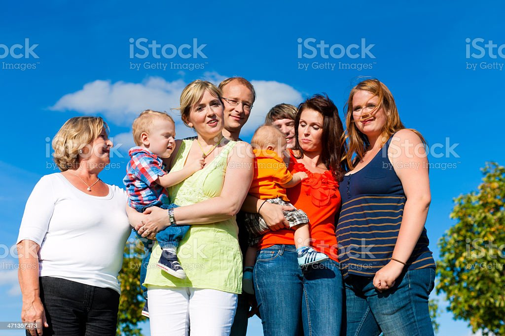 Family and multi-generation - fun on meadow in summer royalty-free stock photo