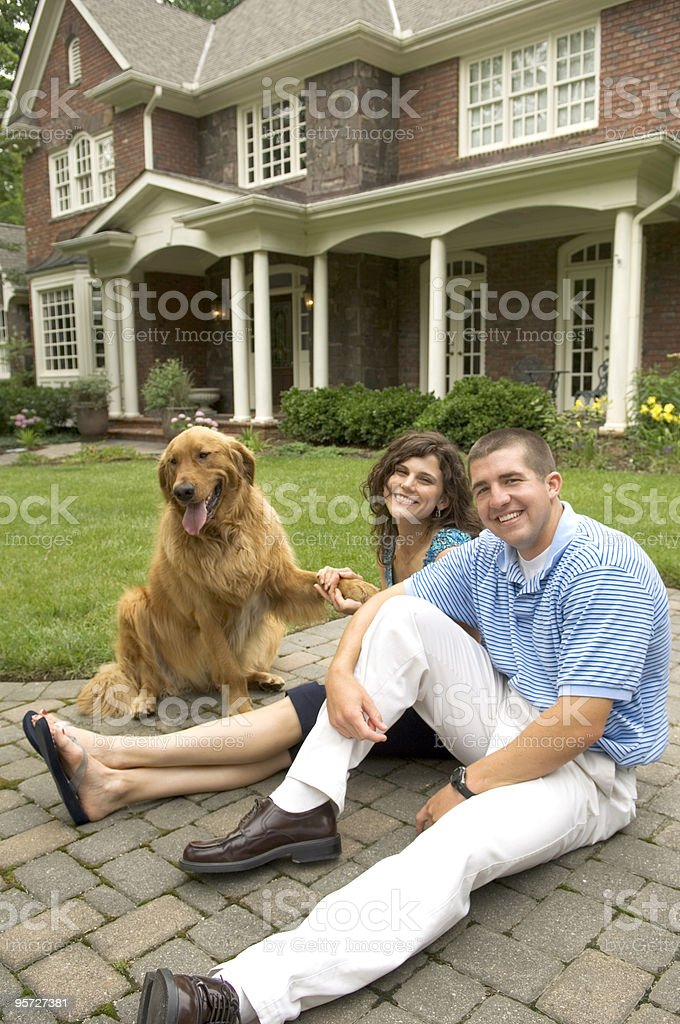 Family and pet in front of home royalty-free stock photo