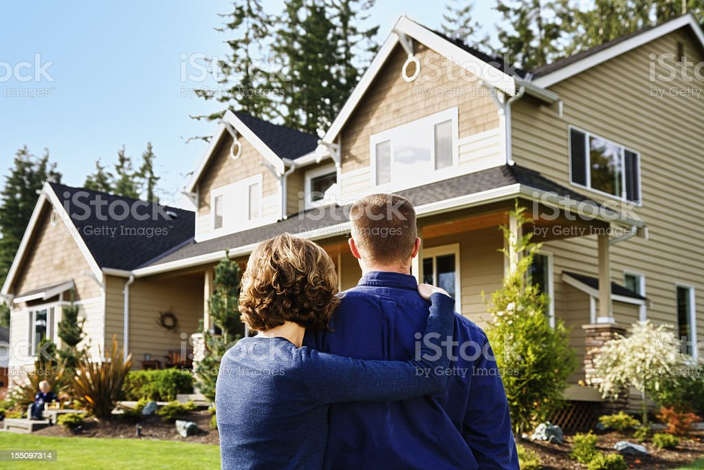 Family and their new home boy on step stock photo
