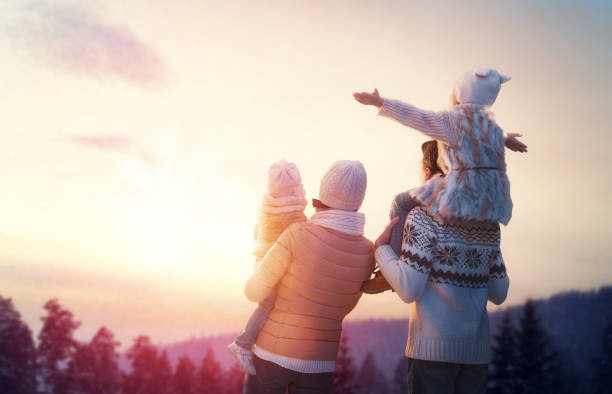 family and winter season - family vacation stock photos and pictures