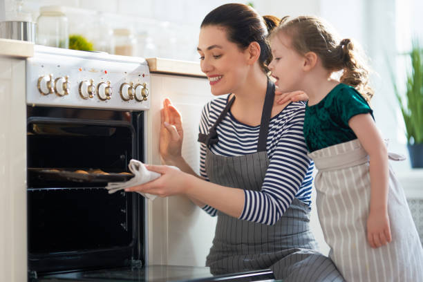 family are preparing bakery together stock photo
