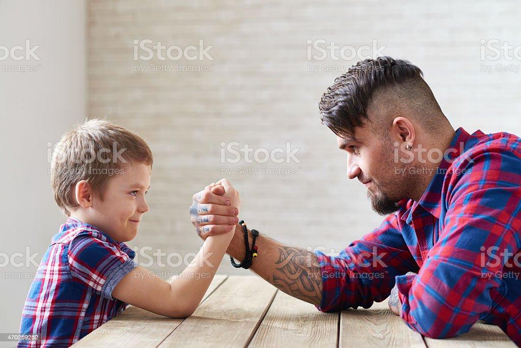 Family arm wrestling stock photo