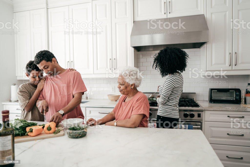 Family around the kitchen island stock photo