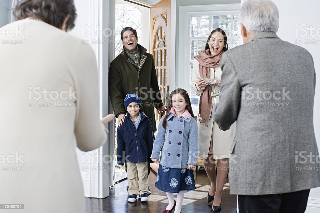 Family arriving at grandparents house stock photo