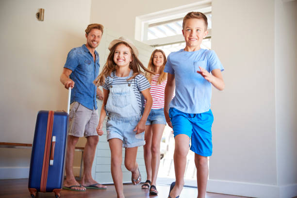 family arriving at summer vacation rental - family vacation stock photos and pictures