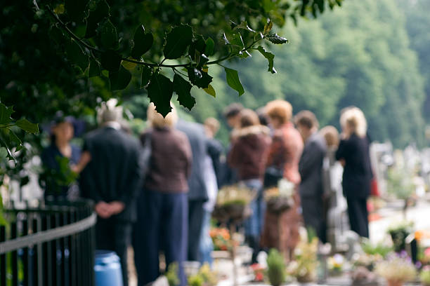 family at a burial - grief stock photos and pictures