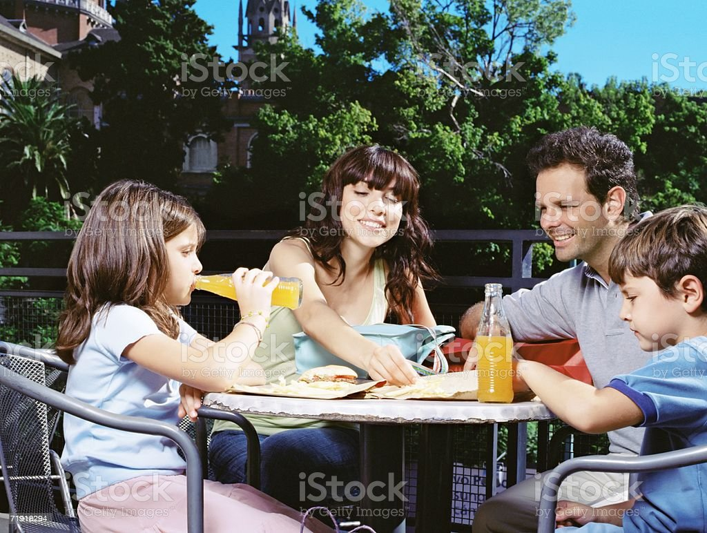Family at a cafe outdoors royalty-free stock photo