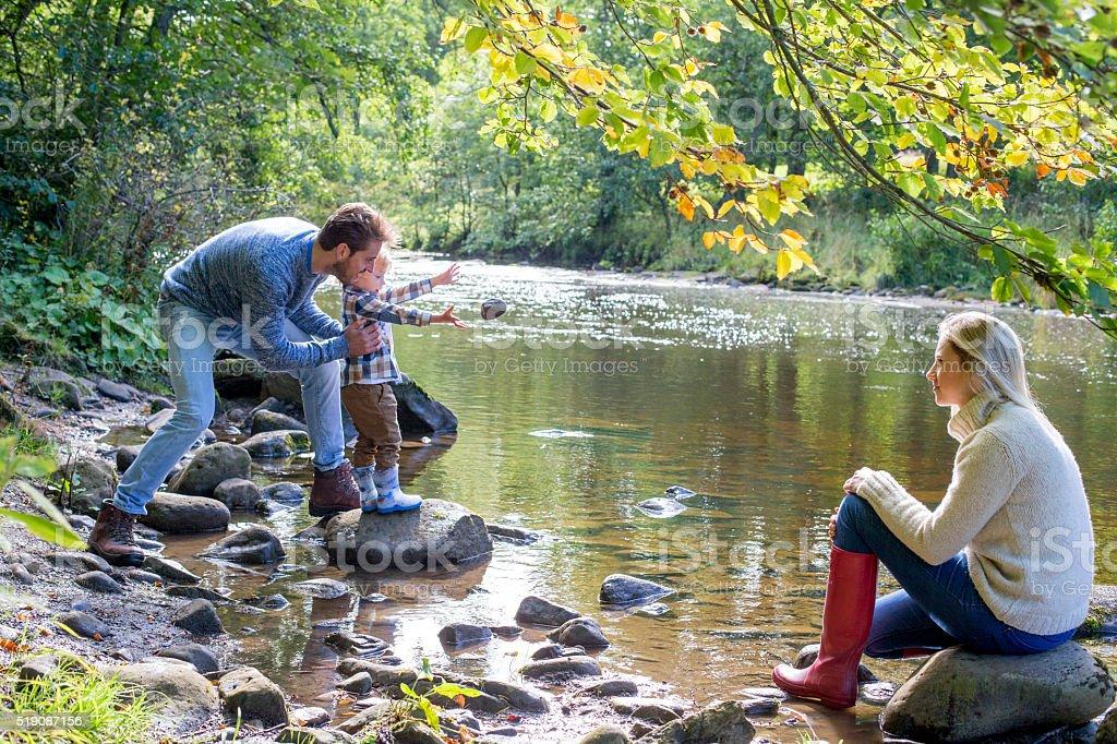 Family at a lake stock photo