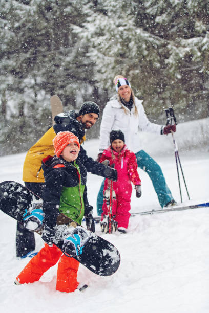 Family at a ski resort stock photo