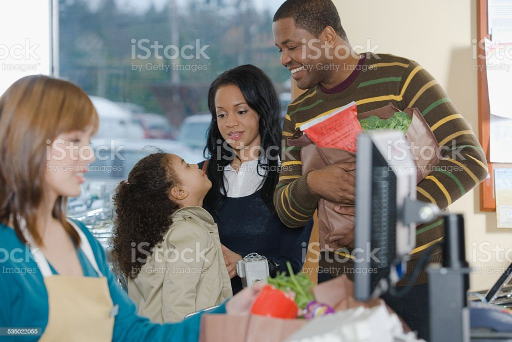 family at a till stock photo