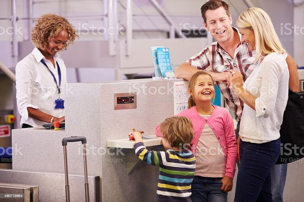 Family At Airport Check In Desk Leaving On Vacation stock photo
