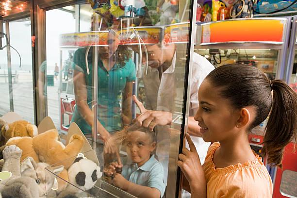 Family at amusement arcade stock photo