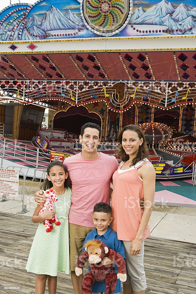 Family at amusement park 免版稅 stock photo