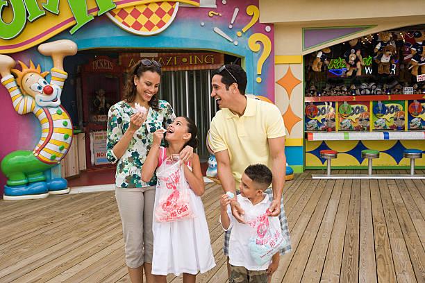 Family at amusement park stock photo
