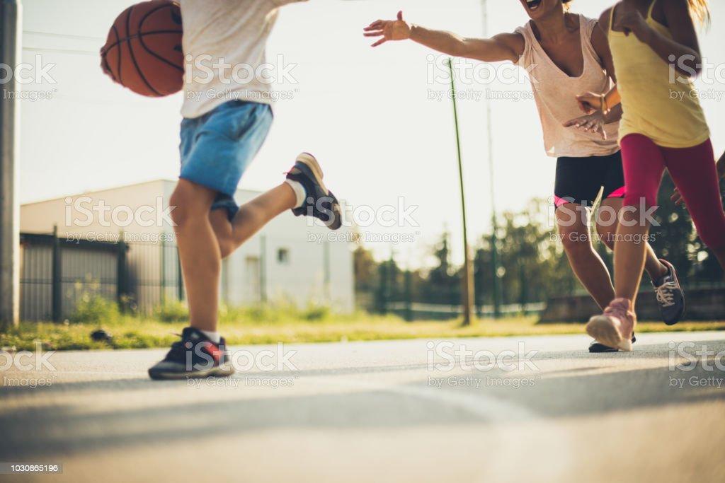 Family at basket. Moving activity. Human body part.
