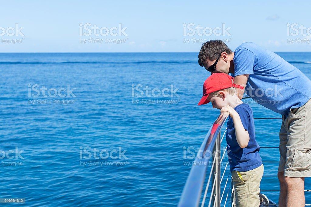 family at boat stock photo
